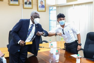 Guyana Civil Aviation Authority Director General, Lt. Col. Egbert Field and newly-licensed pilot, Captain Azam Ally