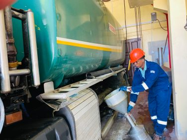 GNBS Inspector Verifying Fuel Tanker Wagon Compartment