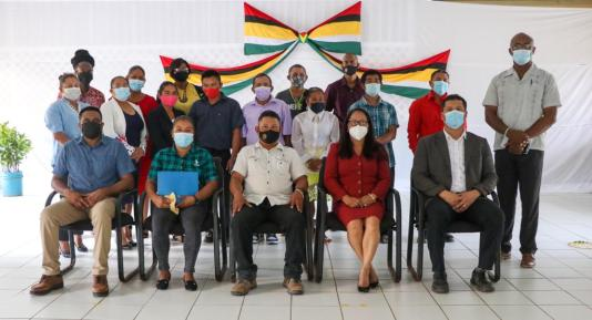 Seated L-R: Minister of Local Government and Regional Development, Hon. Nigel Dharamlall; RDC Vice Chairman, Ms. Claris Francisco; RDC Chairman, Mr. Headley Pio; Minister of Amerindian Affairs, Hon. Pauline Sukhai and Deputy Speaker of the National Assembly, Mr. Lenox Shuman. Region Eight's new RDC are pictured standing, along with Mahdia's Mayor, Mr. David Adams, pictured first, right