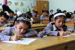 First Day of School in Gaza Children in their classroom at a school run by the UN Relief and Works Agency for Palestine Refugees in the Near East (UNRWA), on the first day of the school year. 02 September 2012 > Courtesy of UN photo archives.