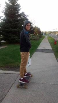 September 2015: Walking with my brother as he longboarded