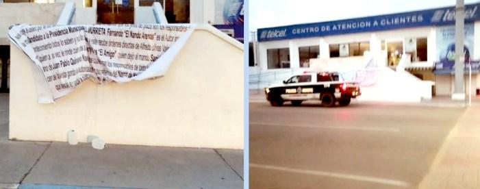 """""""Narco lonas"""" para AMLO; policía las retira"""