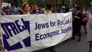 Women holding a banner