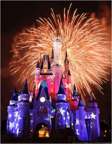 Fireworks light up the sky and illuminated image projections create a patriotic exterior on Cinderella Castle at the Magic Kingdom in Lake Buena Vista, Fla.  Spectacular fireworks displays with brilliant bursts of light coloring the night sky above the theme parks have been a Walt Disney World Resort entertainment specialty for decades. The July 4th fireworks typically are one of the most elaborate nighttime spectacles ever seen at a Disney theme park.  (David Roark, photographer)