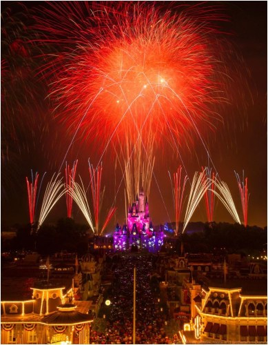 "A red, white and blue fireworks spectacular illuminates the sky over Cinderella Castle at Magic Kingdom in Lake Buena Vista, Fla. Spectacular fireworks displays with brilliant bursts of light coloring the night sky above the theme parks have been a Walt Disney World Resort entertainment specialty for decades. Magic Kingdom honors America each year with a Fourth of July celebration on July 3 and 4 with ""Disney's Celebrate America! A Fourth of July Concert in the Sky,"" which features dazzling comets and glittery bursts soaring to a  musical score produced in a concert band style.  (David Roark, photographer)"