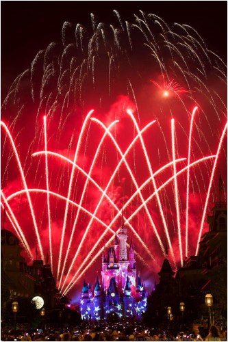 "A red, white and blue fireworks spectacular illuminates the sky over Cinderella Castle at Magic Kingdom in Lake Buena Vista, Fla. Spectacular fireworks displays with brilliant bursts of light coloring the night sky above the theme parks have been a Walt Disney World Resort entertainment specialty for decades. Magic Kingdom honors America each year with a Fourth of July celebration on July 3 and 4 with ""Disney's Celebrate America! A Fourth of July Concert in the Sky,"" which features dazzling comets and glittery bursts soaring to a  musical score produced in a concert band style.  (Ryan Wendler, photographer)"