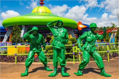 """Green Army Men await guests who visit Toy Story Land at Disney's Hollywood Studios. They march through the land several times a day and stop to play """"Sarge Says"""" with guests, plus other games. The 11-acre land transports Walt Disney World guests into the adventurous outdoors of Andy's backyard, where they will feel like they are the size of a toy. (Matt Stroshane, photographer)"""