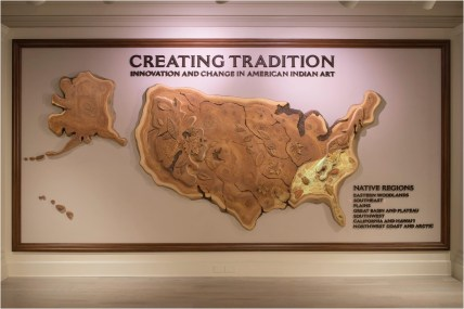 """A dynamic map of the United States sets the stage for """"Creating Tradition: Innovation and Change in American Indian Art"""" exhibit in the American Adventure pavilion at Epcot. The map features undulating projections highlight the seven American Indian regions across the nation. Music playing in the gallery derives from American Indian tribes and regions represented throughout the exhibition. The gallery showcases the work of contemporary Native artists alongside artifacts from centuries past. The pieces demonstrate how ancestral American Indian craftsmanship influences modern generations of Native artists. (David Roark, photographer)"""