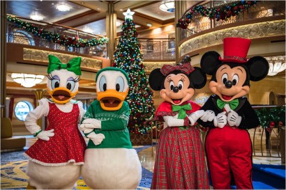 "In the spirit of holiday cheer, Disney Cruise Line adds sparkle to each ship during Very Merrytime Cruises, with Disney characters dressed in festive attire, special stem-to-stern holiday events, traditional ""turkey day"" fanfare, Christmas feasts, ""snow flurries"" and New Year's Eve galas. (Matt Stroshane, photographer)"
