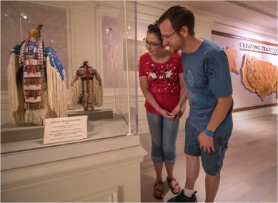 "Walt Disney World Resort guests see how intricate American Indian beadwork techniques are passed down through generations while viewing dolls on display in ""Creating Tradition: Innovation and Change in American Indian Art"" inside The American Adventure pavilion at Epcot. The dolls were created by artists Juanita Growing Thunder and her grandmother, Joyce Growing Thunder, with the Assiniboine/Sioux tribes. Both dolls are on loan from the Smithsonian's National Museum of the American Indian. The exhibition showcases the work of contemporary Native artists alongside artifacts from centuries past, demonstrating how ancestral craftsmanship influences modern generations. (Kent Phillips, photographer)"