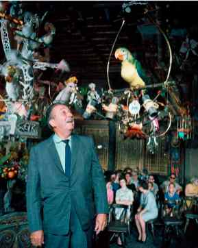 WALT DISNEY AT THE ENCHANTED TIKI ROOM (1963) -Ð The first attraction to feature sophisticated Audio-Animatronics figures opened June 23, 1963. The show features more than 200 birds, tikis and flowers. (Disneyland Resort)