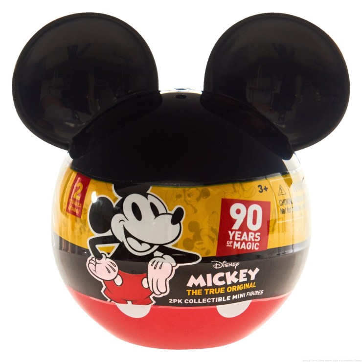 "Licensee: Just Play MSRP: $4.99 Description: Celebrate 90 years of Disney Magic with the Mickey's 90th Anniversary 2-Pack Mini Figures! These surprise Mickey Mouse shaped capsules each contain two 2.25"" figures inside – open the capsule to reveal the two new additions to your Disney collection! Collect Mickey Mouse through the ages with these highly detailed posed figures including: Plane Crazy Mickey & Classic Mickey; Pie Eye Mickey & Sorcerer's Apprentice Mickey; Comic Mickey & Clubhouse Mickey; Steamboat Willie & Technicolor Mickey; New Shorts Mickey & Mouseketeer Mickey. Each capsule is sold separately, and figures come in a fun mini size – perfect for kids and collectors alike. Availability: 8/20 Retailer: Target, KMart, Walmart"