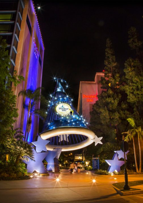 Disneyland Hotel Ð The sorcerer's hat that serves as a gateway between the Downtown Disney District and the Disneyland Hotel features blue and silver detailing, Tinker Bell, and twinkling lights at night. The Disneyland Hotel features 975 rooms in three themed towers based on Frontierland, Fantasyland and Adventureland in Disneyland park. The pool-and-slide water play area evokes the early years of Disneyland park, and features the poolside Tangaroa Terrace restaurant and Trader SamÕs bar, inspired by classic features found in Adventureland in Disneyland park. (Paul Hiffmeyer/Disneyland)