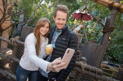 Guests take a selfie with Rosita at The Tropical Hideaway Ð the destination for extraordinary worldly eats in Adventureland at Disneyland Park. This friendly bird likes to make small talk with world travelers passing through The Tropical Hideaway. Disneyland Park is located in Anaheim, Calif. (Christian Thompson/Disneyland Resort)