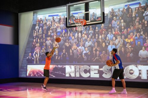Guests at NBA Experience can test their skills at Shoot! where they step onto the court and hear the roar of the crowd while maneuvering through a series of last-second shots before the clock expires. NBA Experience immerses guests of all ages and skills into the world of professional basketball as both a fan and player at Disney Springs at Walt Disney World Resort in Lake Buena Vista, Fla. (Steven Diaz, photographer)