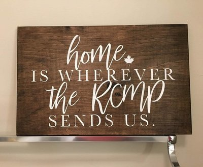 'Home is where the RCMP sends us' Sign
