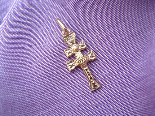 Close-up of gold-plated sterling silver decorative Caravaca cross