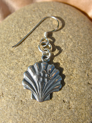 Close-up of Compostela earring with the scallop shell and St James cross