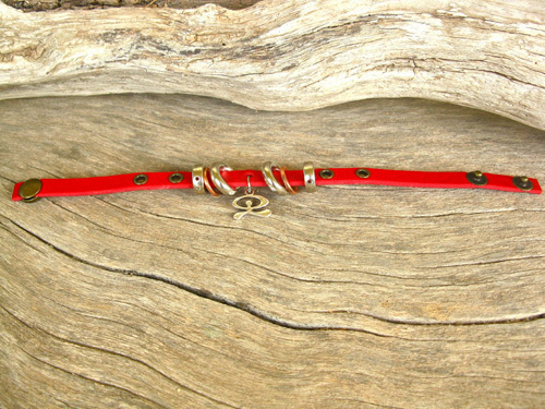 Length of bracelet is flexible with two popper fasteners