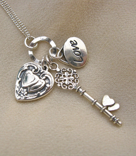 3-part key to my heart charms hang on sterling silver wavy ring