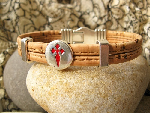 The two strand cork bracelet features a round St James cross charm