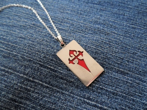 Silver dog tag with hand painted red St James cross