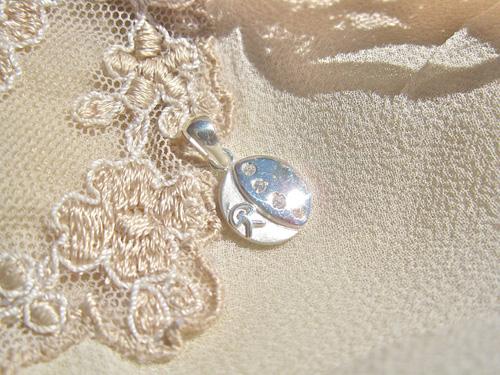 Button pendant ~ lucky Indalo,  silver