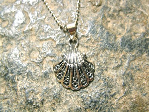 Close-up of the pretty silver filigree scallop shell