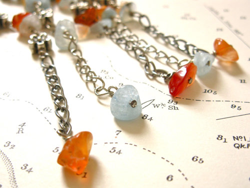 The extender chain is finished with a little chip of agate or aquamarine