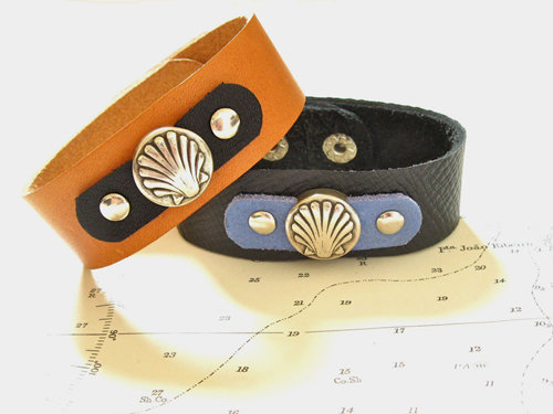 25mm wide leather bracelets featuring the  scallop shell symbol