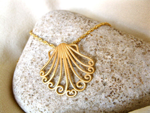 Close-up of the pretty gold plated silver scallop shell - large size
