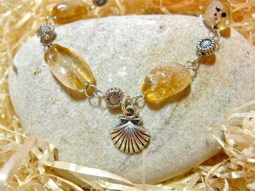 Lovely soft golden yellow Citrine and little flowers make up this inspirational bracelet