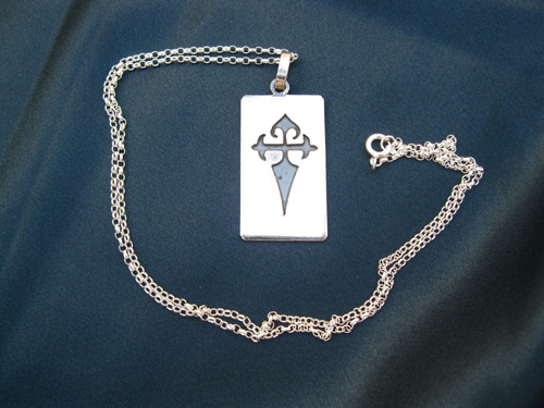 The dog tag hangs on a silver belcher chain