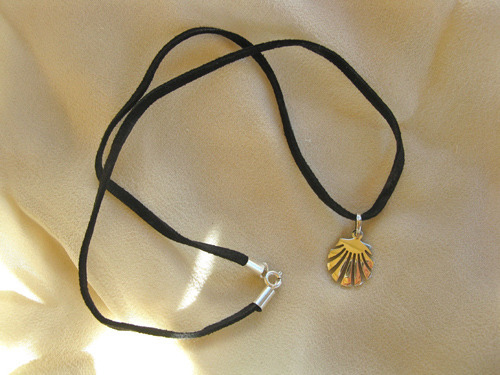 Sterling silver scallop shell on black leather cord