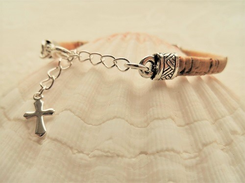The Camino bracelet is adjustable with the extender chain featuring a tiny cross