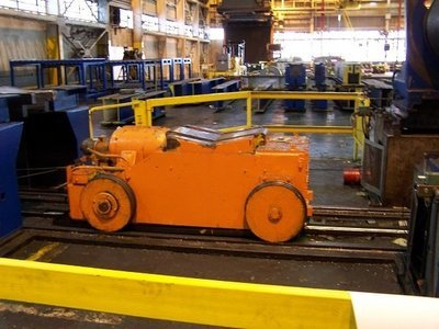 1 - USED 50,000 LB. AUTOMATIC FEED COIL CAR WITH PARKING STAND
