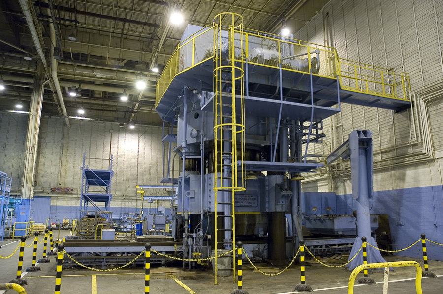 1 – USED HPM 7,000 TON HI-DRAW VERTICAL HYDRAULIC DOWN ACTING FOUR POST GUIDED RAM PRESS WITH 6,300 TON CHUSION