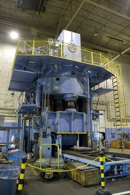 1 – USED HPM 7,000 TON HI-DRAW VERTICAL HYDRAULIC DOWN ACTING FOUR POST GUIDED RAM PRESS WITH 6,300 TON CUSHION