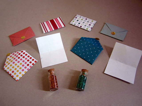 3 envelopes & vial of fairy dust