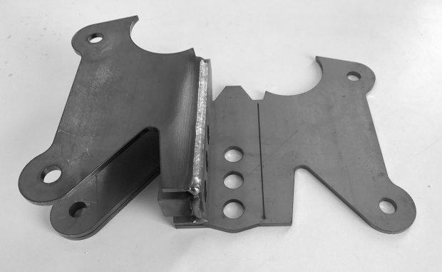 Folded/welded bracket on top of flat bracket.