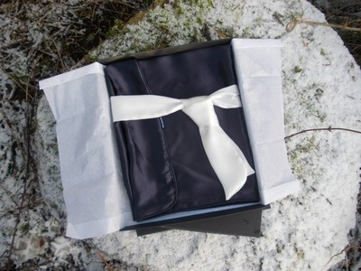 Single dark blue silk pillowcase with hand-rolled edges.