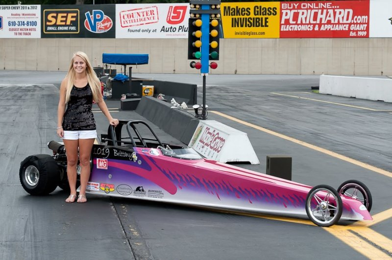 Brittany Boltz senior photo with jr dragster