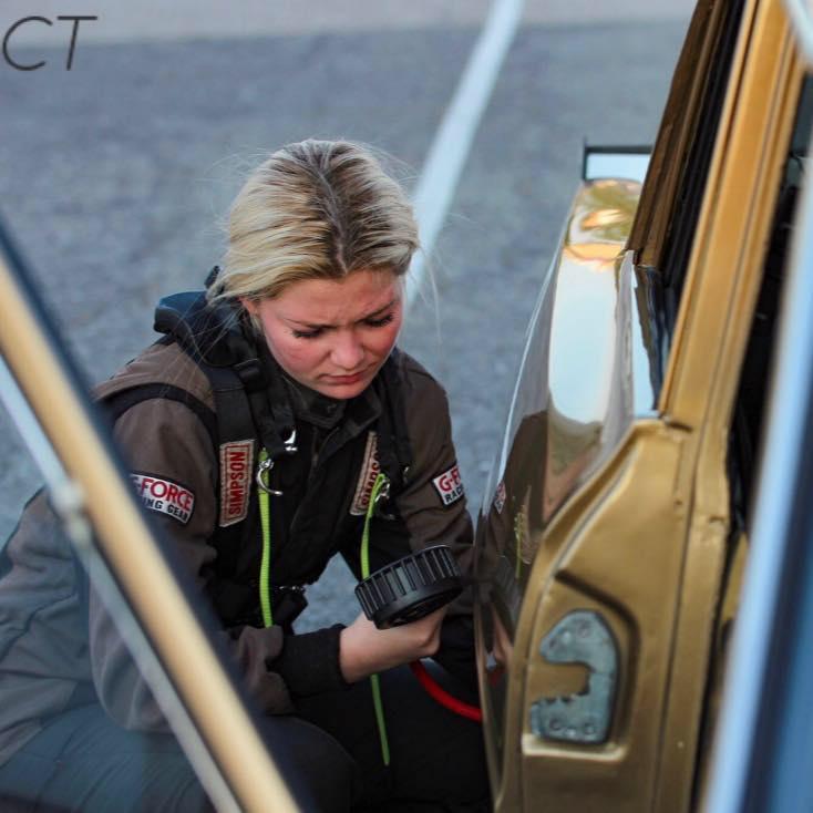 Maddie Malone checking tires