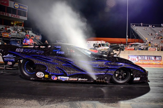 Texas racer Randell Reid, the Pro Extreme class winner at the PDRA's most recent event in Memphis, clears the motor in his '07 Corvette before launching in round two of qualifying for the PDRA Summer Drags.