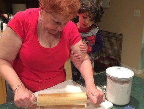 Bubbe teaching DJ how to roll pie crust.