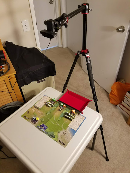 Webcam mounted on a tripod over the game area.