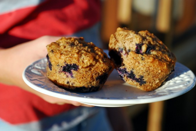 plate of blueberry muffins in hand 2