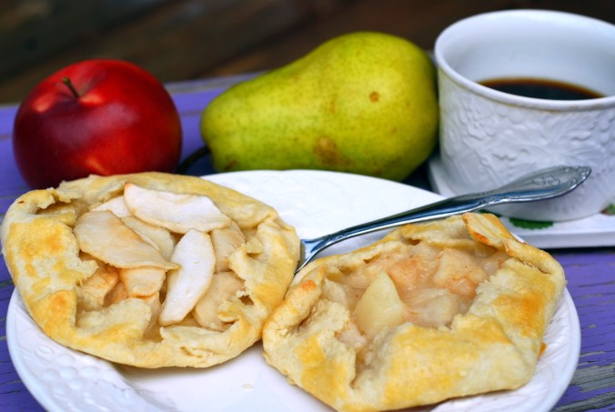 apple and pear galettes with fruit and coffee