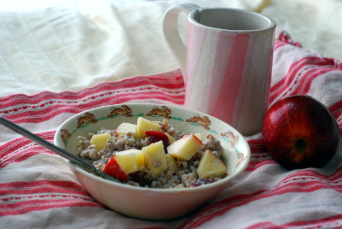wheatberry breakfast bowl with mug and apple