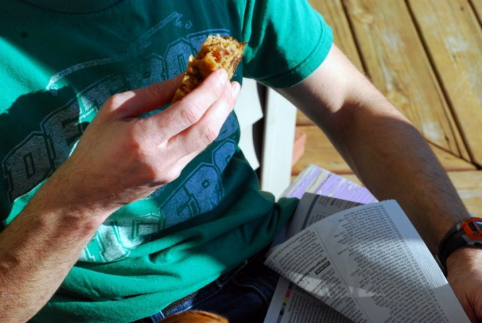 date bread in hand on porch